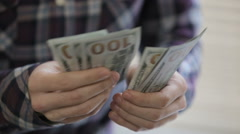 Man's hands counting money dollar bills.close up Stock Footage