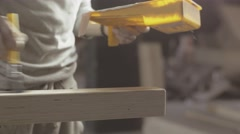 Woodworker paint varnish long wooden board by brush, roller. Manufacturer Stock Footage