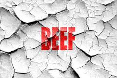 Grunge cracked Delicious beef sign - stock illustration