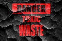 Grunge cracked Toxic waste sign - stock illustration