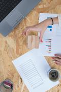 Financial business news online on a laptop with coffee and stationery Stock Photos