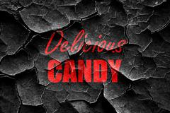 Grunge cracked Delicious candy sign - stock illustration