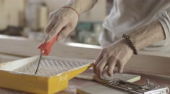 Woodworker dye varnish long wooden board by production roller. Manufacturer - stock footage