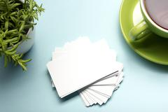 Stock Photo of Business card blank over office table. Corporate stationery branding mock-up