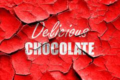 Grunge cracked Delicious chocolate sign - stock illustration