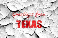 Grunge cracked Greetings from texas Stock Illustration
