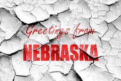 Grunge cracked Greetings from nebraska - stock illustration