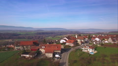 4K aerial shot flying toward a lovely town Stock Footage
