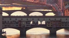 Ponte Vecchio bridge at sunset in Florence, Italy Stock Footage