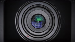 Camera lens and light reflection in optics - transition, zoom out, loop - stock footage