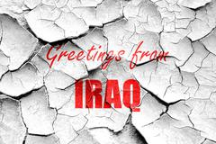 Grunge cracked Greetings from iraq Stock Illustration