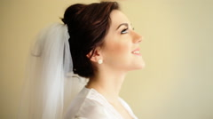 Young adorable happy bride touching her wedding dress and smile on camera - stock footage