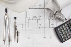 Architectural blueprints, blueprint rolls, compass divider, calc - stock photo