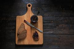 Stock Photo of The top view of fruity jam on black wooden table