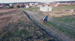 Couple Riding a Quad Bike in the Field - stock footage