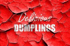 Grunge cracked Delicious dumplings sign Stock Illustration