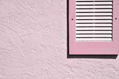 Pink Shutter on Pink Exterior Stucco Wall Stock Photos