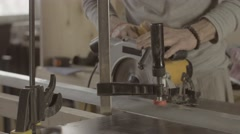 Woodworker cut wooden board on straight line of metal balk. Circular saw Stock Footage