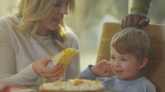 4K Happy family party - adults & children enjoying some birthday cake - stock footage