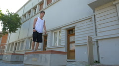 Young athlete performing parkour trick Stock Footage