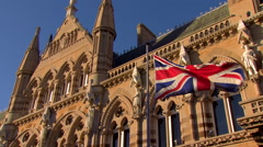 Wide Pan of Union Jack in Front of Guildhall - stock footage