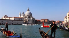 Gondoliers and Gondolas at Venice grand canal Stock Footage