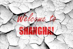 Grunge cracked Welcome to shanghai - stock illustration
