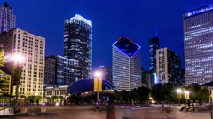 At night,the Cloud Gate and visitors in Millennium Park, Chicago, USA Stock Footage