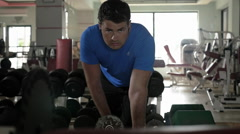 Man exercising with dumbbell in the gym Stock Footage