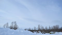 Clouds floating over blue sky, forest and scrapyard timelapse Stock Footage