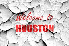 Grunge cracked Welcome to houston - stock illustration