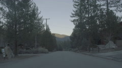 Village road with mountains in background (UNGRADED) Stock Footage