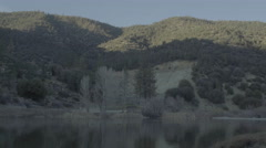Lake with mountains (UNGRADED) Stock Footage