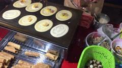Preparing Thai crepes (Khanom bueang) Stock Footage