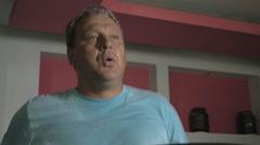 Man having cardio training on treadmill - stock footage