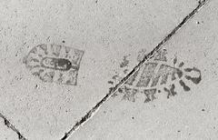 Footstep Imprint on Pavement Stock Photos
