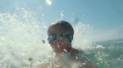 Happy little child enjoying water splashing Stock Footage