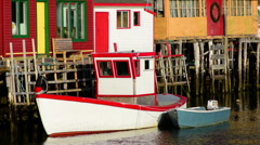 Quidi Vidi Boat docked along side of its home. Stock Footage