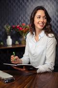 Creative businesswoman writing on planner Kuvituskuvat