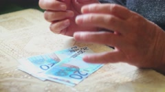 Senior lady counting euro banknotes, selective focus, very shallow DOF, very - stock footage