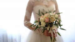 Close up of bride`s hands holding beautiful wedding bouquet of flowers of pink - stock footage