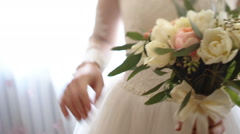 Close up of bride`s hands holding beautiful wedding bouquet of flowers of pink Stock Footage