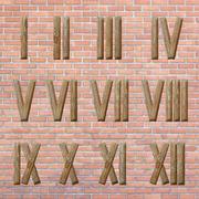 Roman numerals set on brick wall background Stock Photos