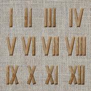 roman numerals set on burlap background - stock photo