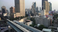 BTS train and cityscape seen from terminal 21 in Sukhumvit Bangkok Stock Footage