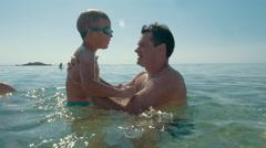 Enjoyable sea bathing with father Stock Footage