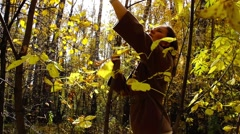 Girl walks in autumn forest Stock Footage