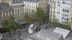 Flock of pigeons flying on the city square in Paris - stock footage