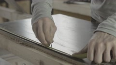 Carpenter measure wooden board by straightedge, make mark. Put metal balk on it Stock Footage