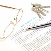 lease agreement document with key - stock photo
